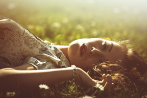 delicate beautiful young woman enjoy in sun lie in grass retro l